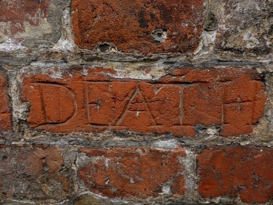 Death is carved into the brickwork in the exercise yard.